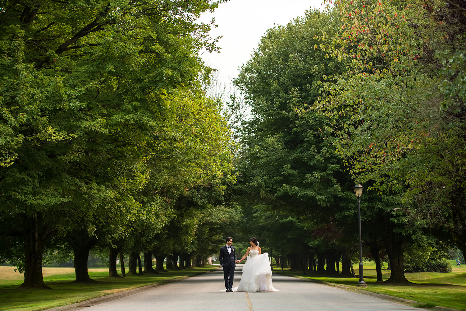 Swaneset Bay entrance with a bride and groom walking down the main drive.